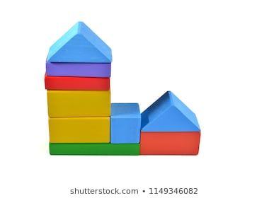 Close up of colorful wooden toy block isolated on white background selective focus
