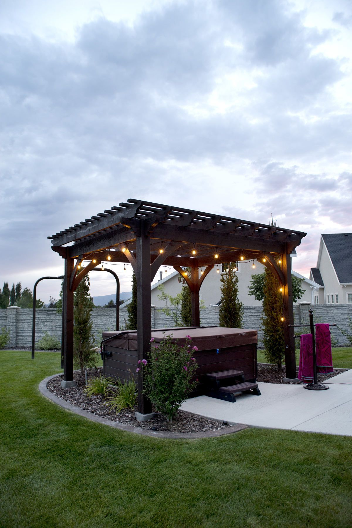 Heavenly haven diy pergola over hot tub with a timber frame trellis for hanging a hammock