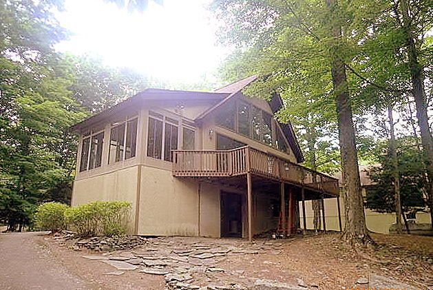 SOLD! Welcome new neighbors. Hideout Nothing to do but Enjoy. Wrapped in a Forest feeling and sitting atop a paved driveway, Cathedral Chalet features open floor plan with a glass front and fireplace, sun deck to 3 season Florida screened Room, builtin lower bar family room with wood stove, and vaulted loft bedroom. Close to Ski slope and around the block to Roamingwood Access water play.