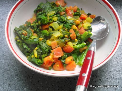 Indian-style Mustard Greens. Spiced mustard greens fried with onion, garlic, ginger and tomato.