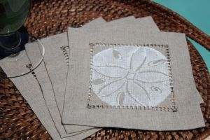 Isola Bella Coasters - White Sand Dollar on Natural Linen.  Sale Price: $13.00