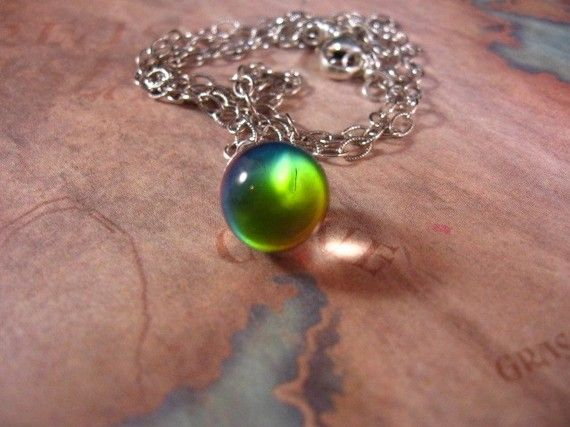 "Crystal Ball Enchanted Necklace. crystal ball changes colors with movement light. Hangs on a silver chain 20"". $29.00 #jewelry #rainbow"