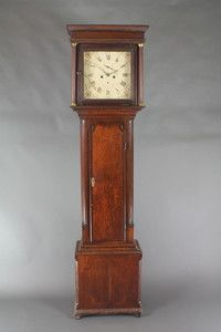 "Lot 785, Houghton of Chorley, an 18th Century 8 day striking  long case clock, the 13"" square painted dial with spandrels, subsidiary second hand and calendar hand, contained in an oak case with crossbanded door and fluted columns to the sides 82""h, est £200-300"