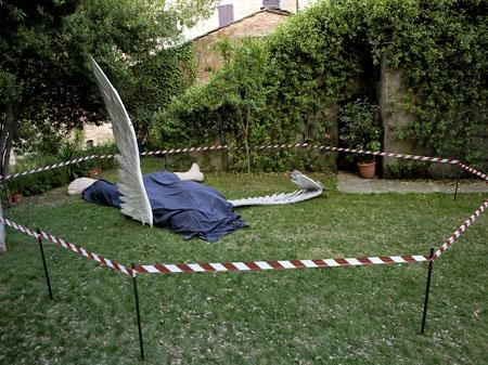 Ilya & Emilia Kabakov, The Fallen Angel, 1997-2004, painted fiberglass figure, wings and cloth, variable dimensions.Galleria Continua San Gimignano, 2009. Photo by Ela Bialkowska