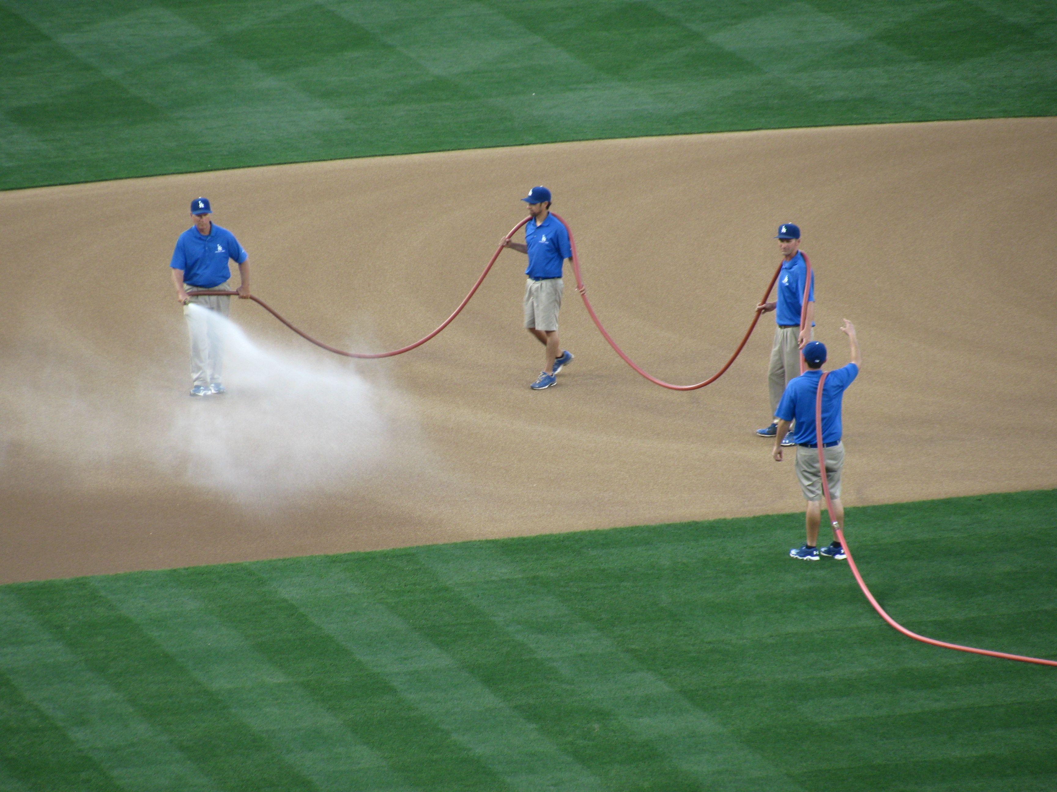 Takes Four Men To Water Down The Infield La Dodgers Baseball Dodgers Baseball Dodger Game