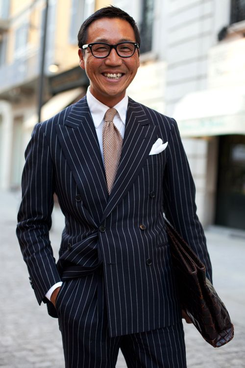 broad pinstripes on a double breasted suit contrasted with a very ...