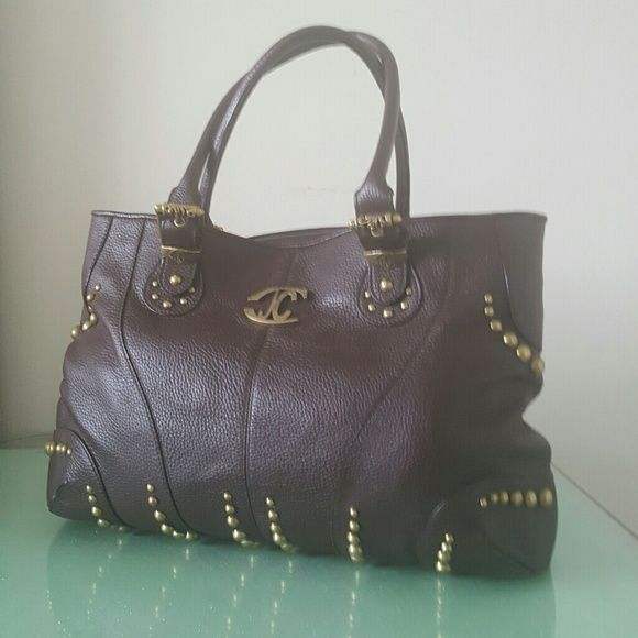 """Just Cavalli  XL Leather Satchel 100 % from authentic from Just Cavalli , bag is absolutely gorgeous and huge XL size, perfect for computer and great for work or school. Going well with many outfits,  since I purchased l didn't have chance to were, been worn previously very gentle. Soft brown leather with brass hardware.  Signature  logo lining , one zippered pocket and additional two pockets for cell phone or accessories. Strap drop 9"""" perfect condition very clean inside. Dimensions 19"""" x…"""
