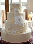 Handmade sugar flowers and lace make for a beautiful cake