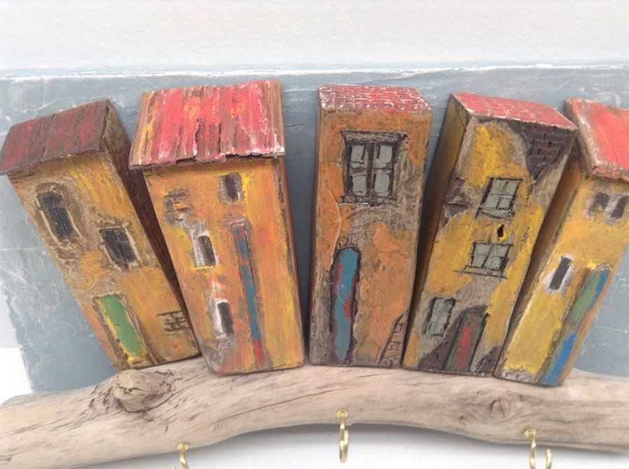 five yellow painted house figurine in Duncan letgo