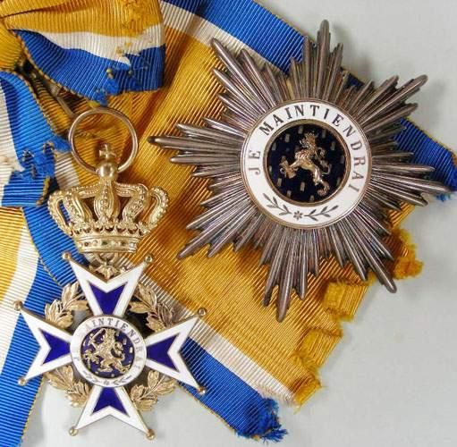 """The Order of Orange-Nassau (Orde van Oranje-Nassau). A military and civil Dutch order of chivalry founded on 4 April 1892 by the Queen regent Emma of the Netherlands, acting on behalf of her under-age daughter Queen Wilhelmina. The Order is a chivalric order open to """"everyone who has earned special merits for society"""". Motto: """"Je maintiendrai"""" (I shall maintain)."""
