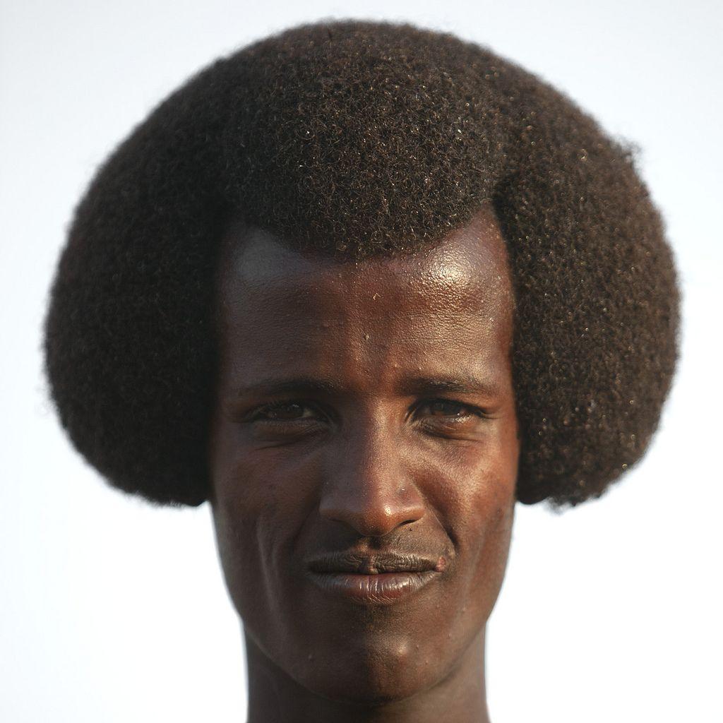 Karrayyu man with his Gunfura traditional hairstyle in Gadaa ceremony - Ethiopia.