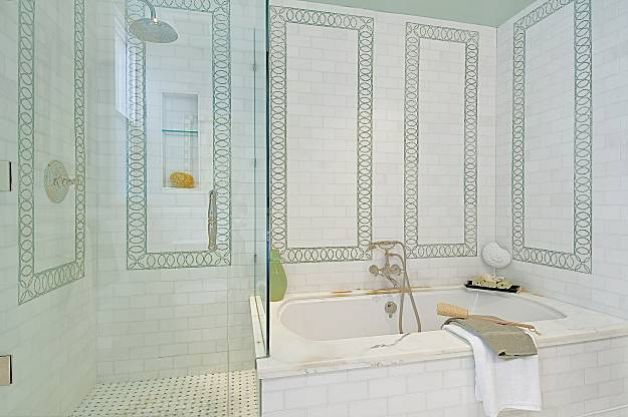 The master bathroom features a stand-up shower and separate tub as well as dual sinks. The property, which was originally built in 1917, was completely remodeled in 2006. Photo: OpenHomesPhotography.com / SF