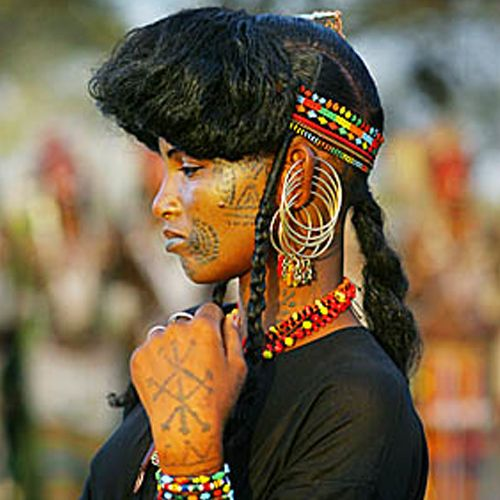 Africa A Wodaabe woman in her finery during the Gerewol