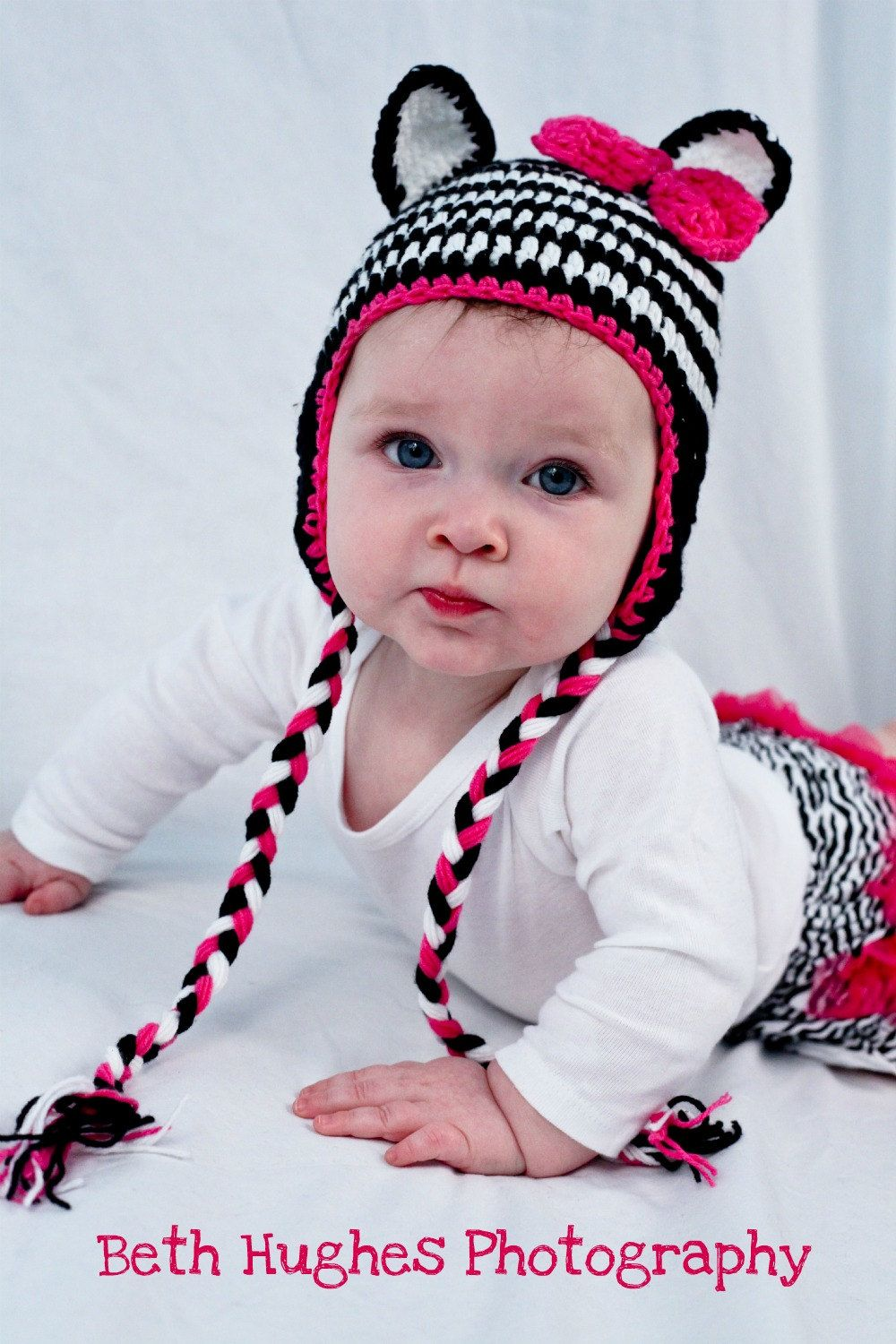 ec6f88d83cb Items similar to Zebra Crochet Earflap Baby Girls Hat With Earflaps Braid  Tassels Pink Bow on Etsy