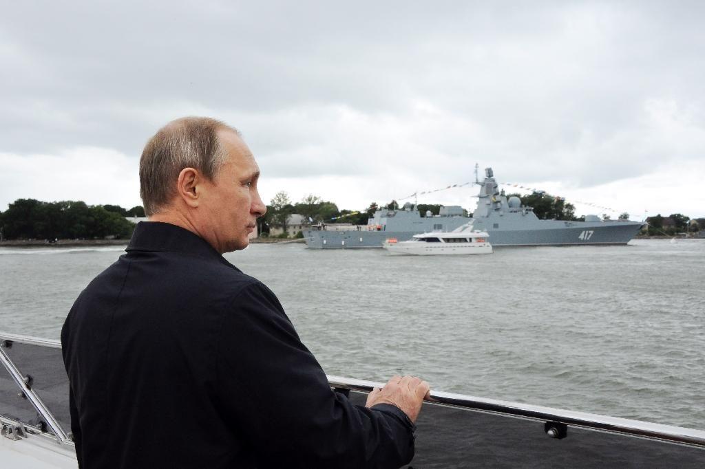 Russian President Vladimir Putin attends a ceremony marking Navy Day in Baltiysk on July 26, 2015