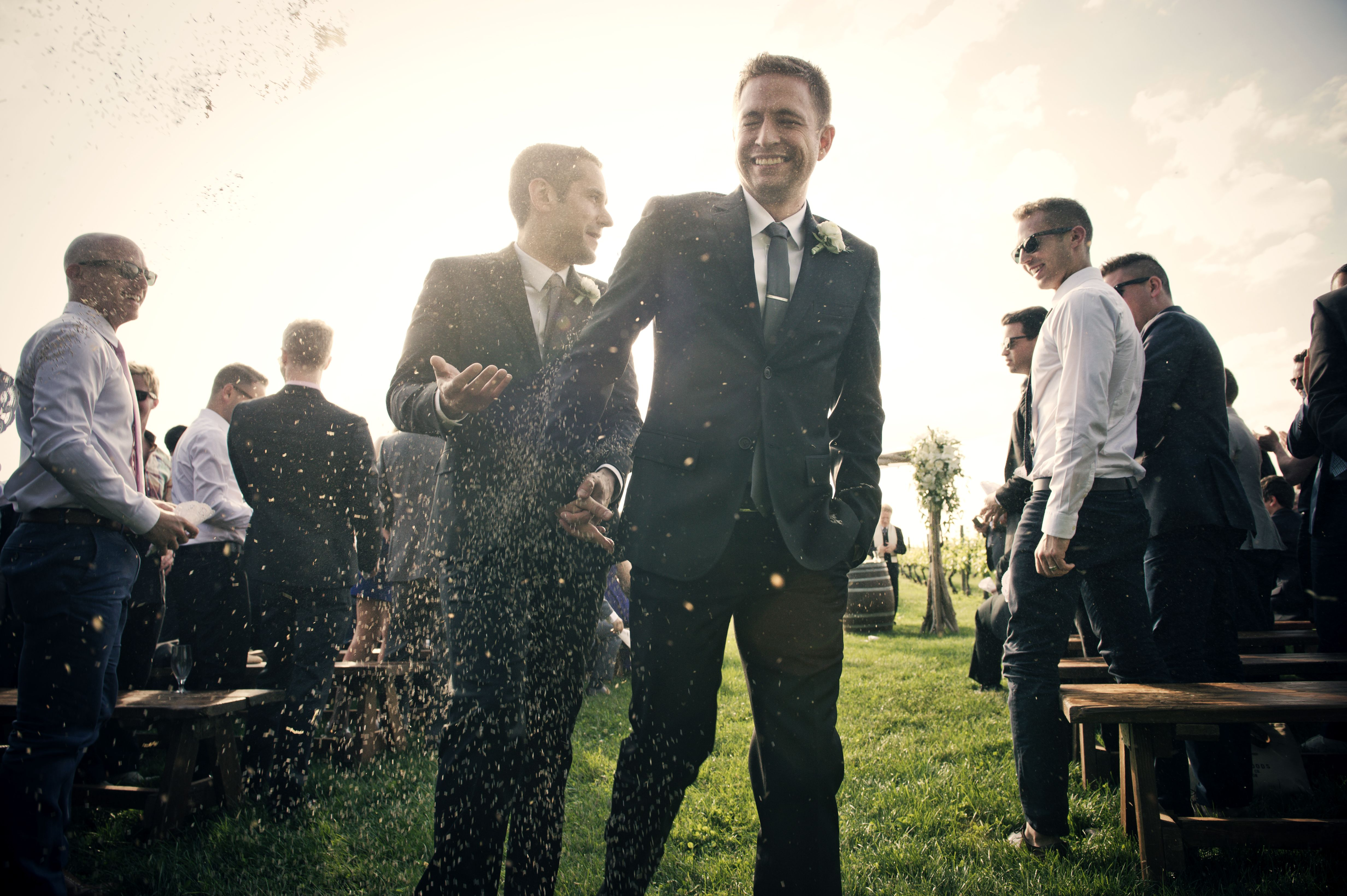 Congratulations to our grooms!  Photo by Mark Kopko.