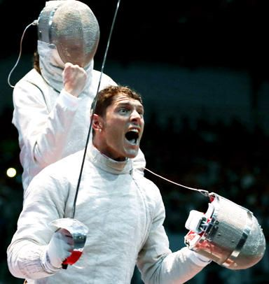 Aliaksandr Buikevich of Belarus, left, and Aldo Montano of Italy, react during a quarterfinal match at men's team saber fencing at the 2012 Summer Olympics. And Montano's reaction was so good we had to show him twice...