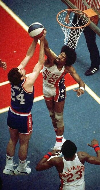 Julius Erving blocking Bobby Jones of Denver Nuggets