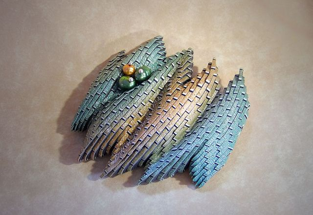 Dimensional landscape brooch in Kato pearl clay by Jana Roberts Benzon. Beautiful