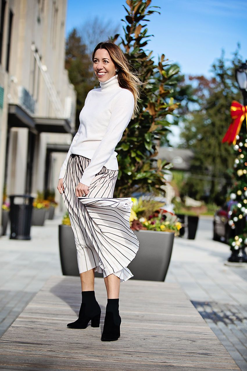 ff33739fca13f The Motherchic wearing an easy holiday party outfit - Party skirts + sock  booties + cashmere. @lordandtaylor #ad