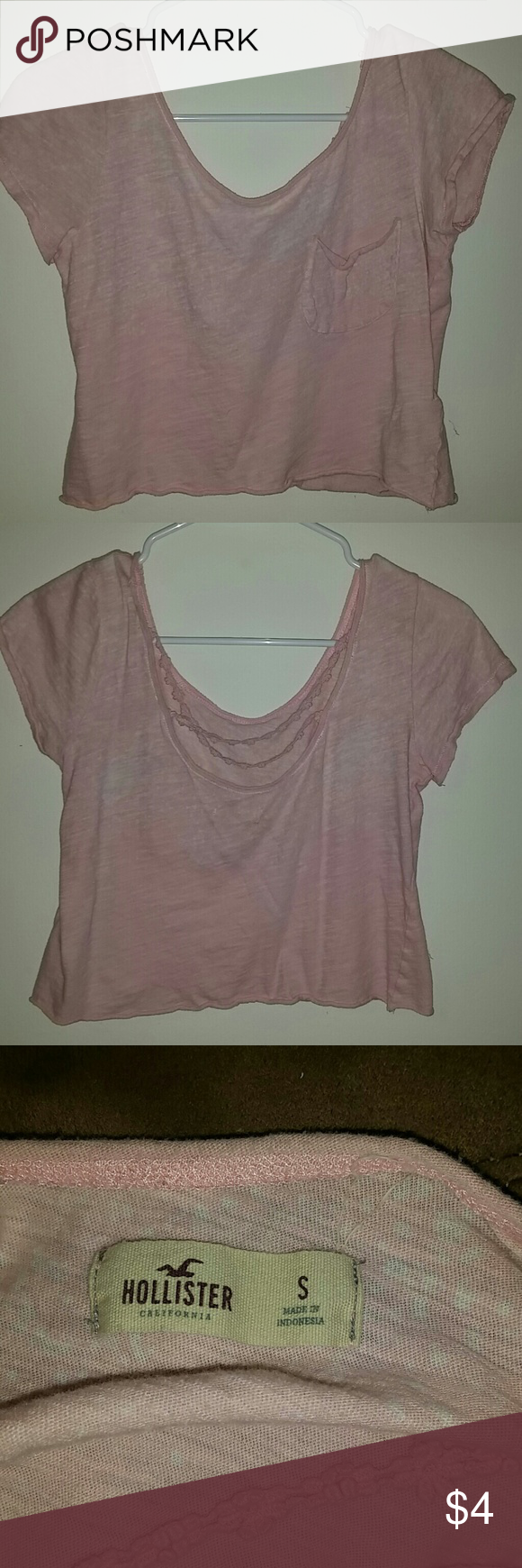 Hollister Faded Pink Crop Top Shirt has a faded pink look to it, also back floral design. One front pocket.  Size Small Hollister Tops Crop Tops