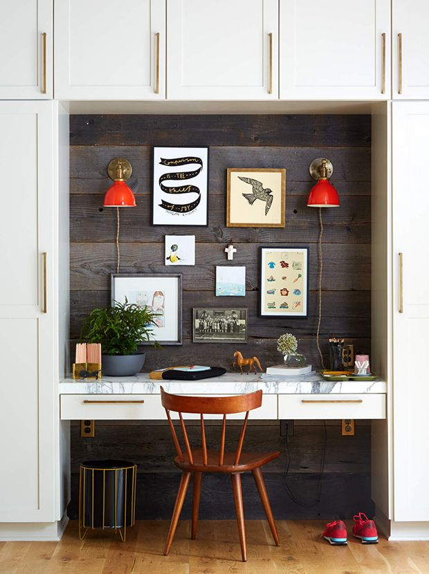 Barnboard and a pair of funky red sconces give this small office area big personality. | Design: Emily Henderson