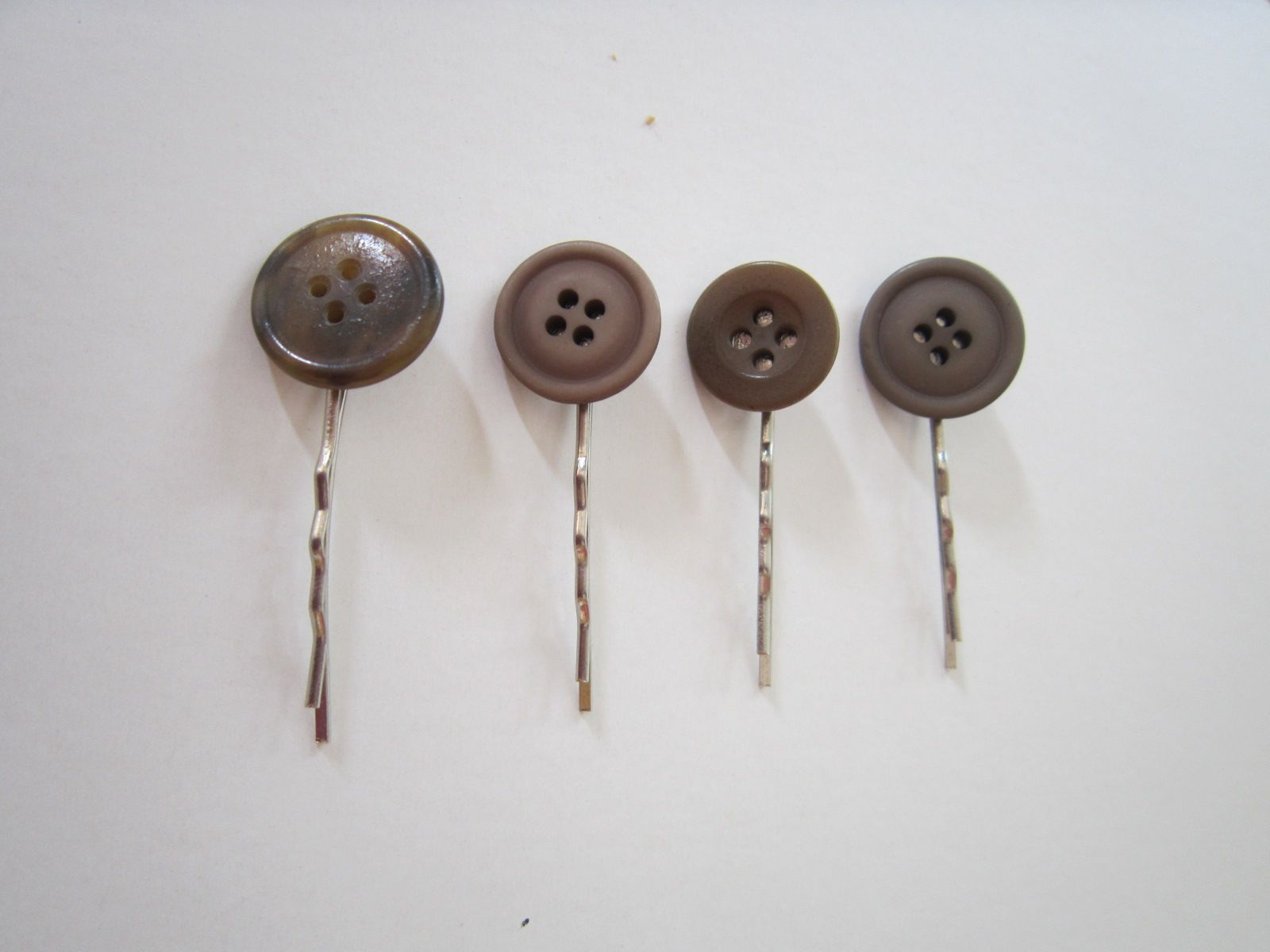 A lovely range of  handmade hair slides featuring vintage buttons to make sure you outdazzle everyone.