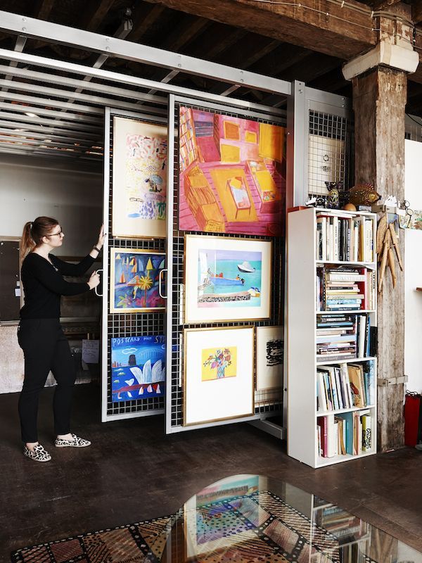 Kirstin Livmanis, one of Ken's staff, showing us his personal archive of work in his studio at The Rocks. Photo – Eve Wilson. Production – L...