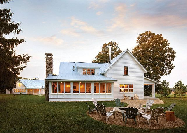 ice cream cone holder exterior farmhouse with adirondack chairs backyard firepit chimney pipe metal roof stone - Stone Farmhouse Exteriors