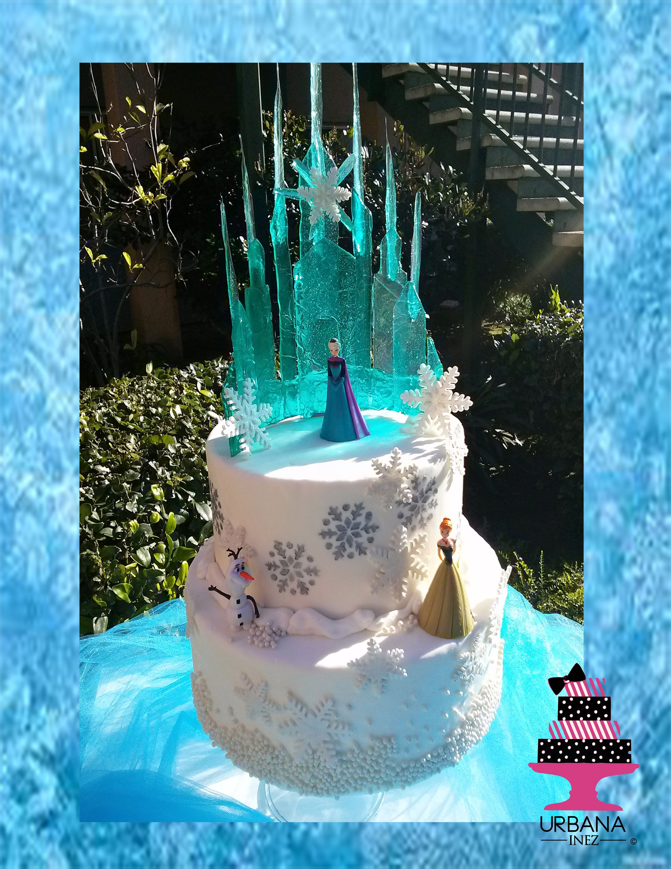 frozen themed cake with edible ice, airbrushing and snowflakes