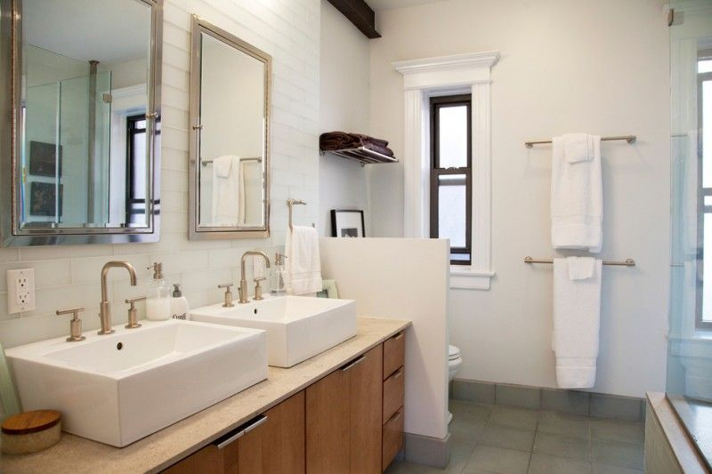 Two white sinks on top of cream counter top with towel rack on the two white sinks on top of cream counter top with towel rack on the side of teraionfo