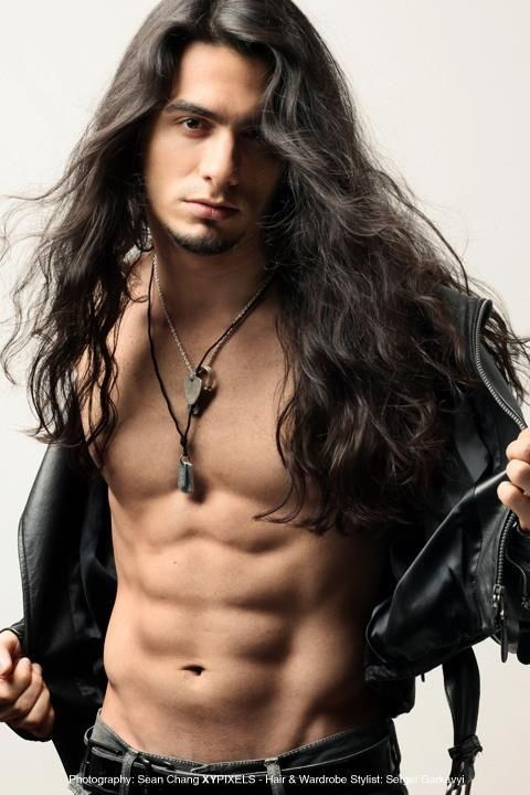 Sexy guy with long hair