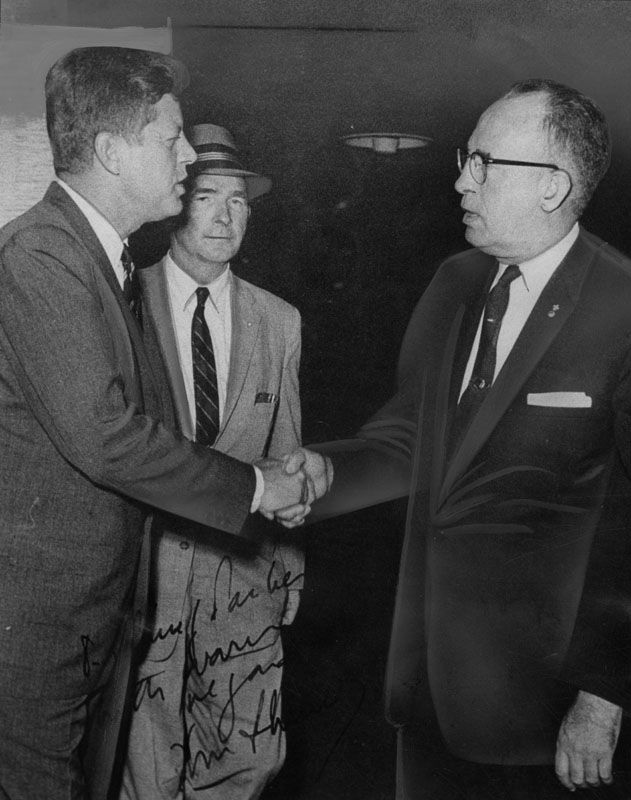 From LAPL: On a visit to LA, John F. Kennedy thanks LAPD Chief Parker for his security detail.