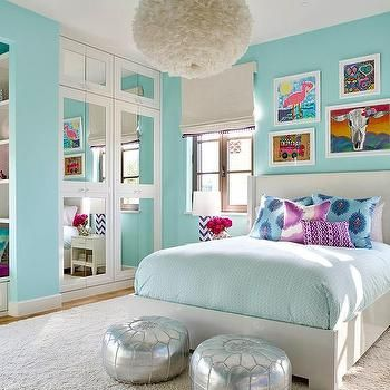 Beautiful Turquoise Blue Girlu0027s Bedroom Features A White Feather Chandelier, Eos  White Pendant, Illuminating A White Wingback Bed Dressed In Pale Blue  Bedding As Well ...