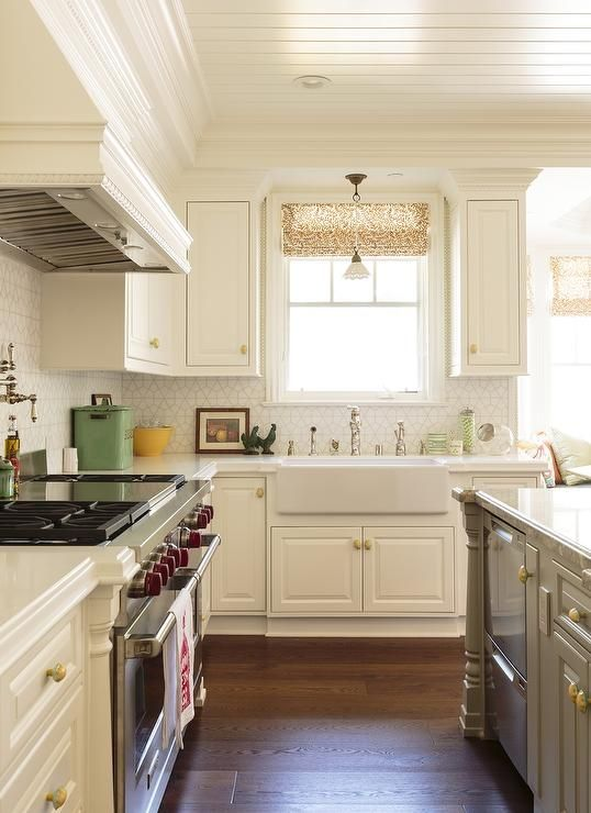 white kitchen with gray island fitted with gold hardware kitchen inspirations kitchen design on kitchen cabinets gold hardware id=20921