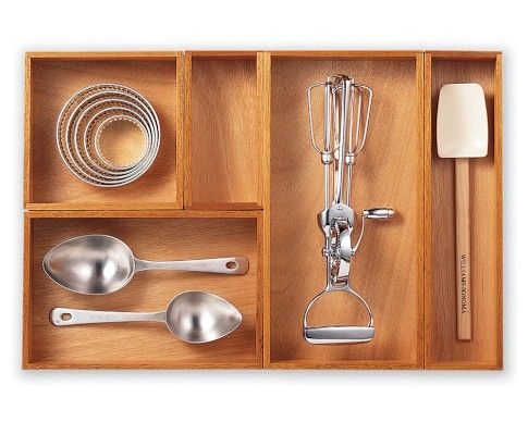 Williams and Sonoma kitchen drawer dividers. I aspire to have drawers like these...is that weird?