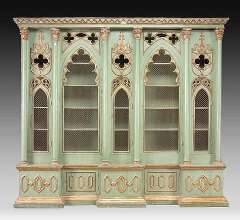 Italian Painted and Parcel Gilt Cabinet - swept leaf carved cornice above gothic arch shaped grilled doors and trefoil carvings divided and flanked by Corinthian columns....c1880