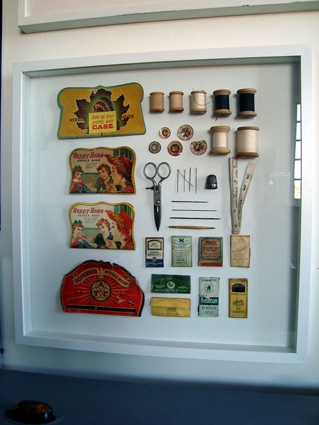 using shadow box frame to display Aunt Kay's sewing supplies