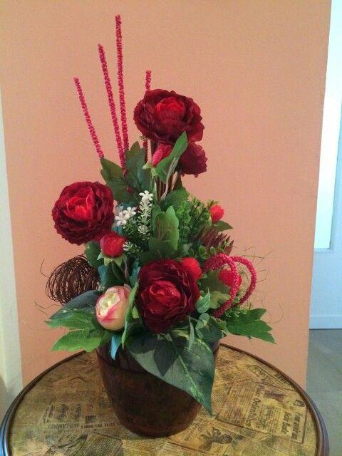 Composizione floreale rose rosse