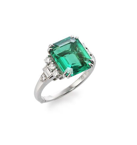 An emerald and diamond ring, by J.E. Caldwell