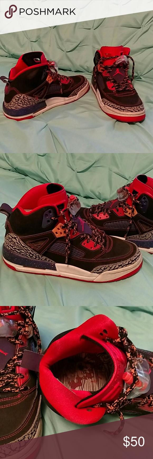 Jordan shoes Purple, orange,  black and grey boys Jordan shoes. Worn but still good. A few spots rubbed but still black as seen in picture. Shoes Sneakers