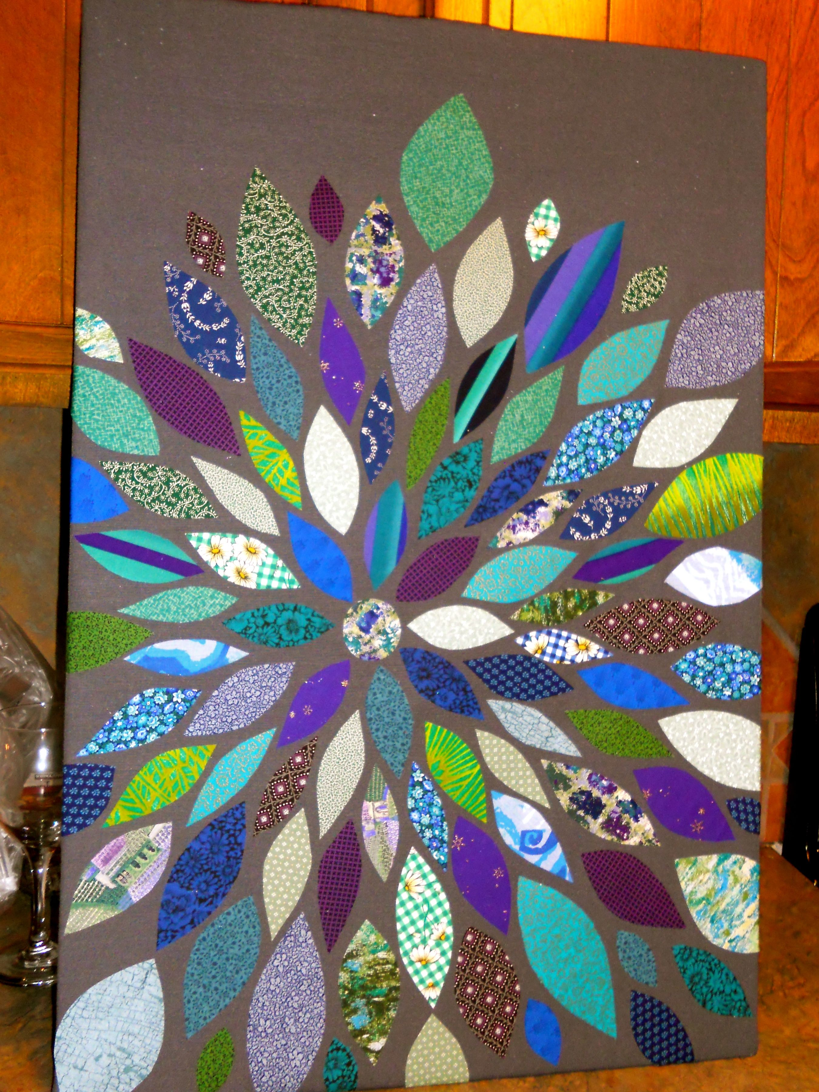 Fabric Wall Art. I could do this with fabric scraps from