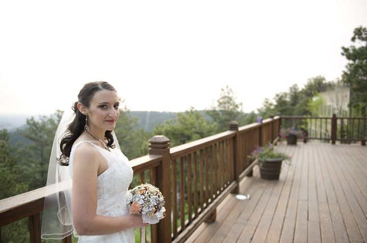The bride wears a Vintage-inspired wedding gown for a wedding in Colorado Moutains | fabmood.com #wedding #weddingdress #vintagegown #vintageinspired #weddinggown