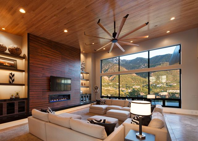 Downlights in a wood ceiling with a large ceiling fan Interior