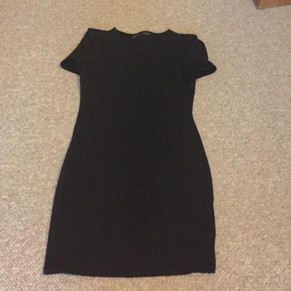 Zara black dress Short sleeved dress from Zara! Suze medium. Barely worn. Cotton/poly blend. Comes right about the knee. Zara Dresses Mini