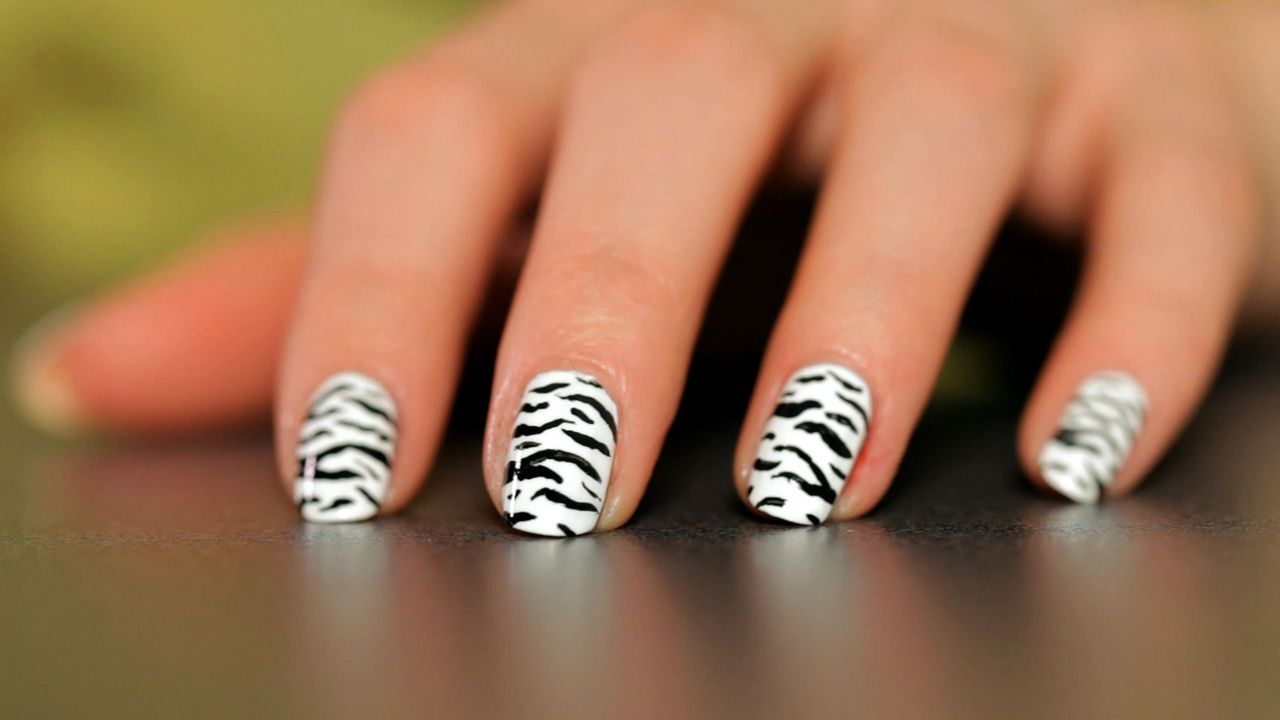Learn how to do a zebra nail design from Megan Toth in this Howcast ...