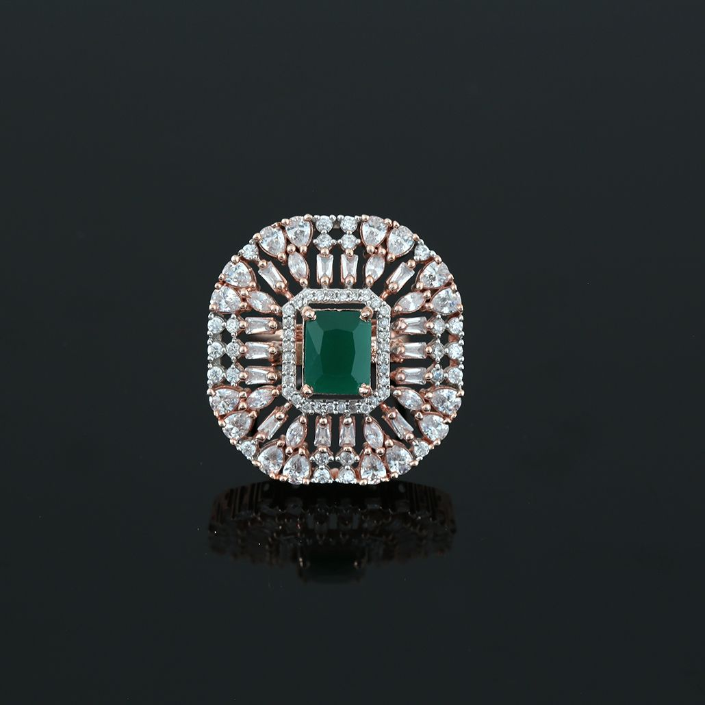 SYNTHETIC GREEN CZ CENTER PIECE AND CLEAR RHINESTONE STUDDED FLOWER RING