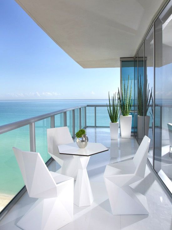 How To Furnish House With Modern Furniture: Gorgeous #beach High Rise With Glass #patio, #contemporary White Furniture, And An Amazing View