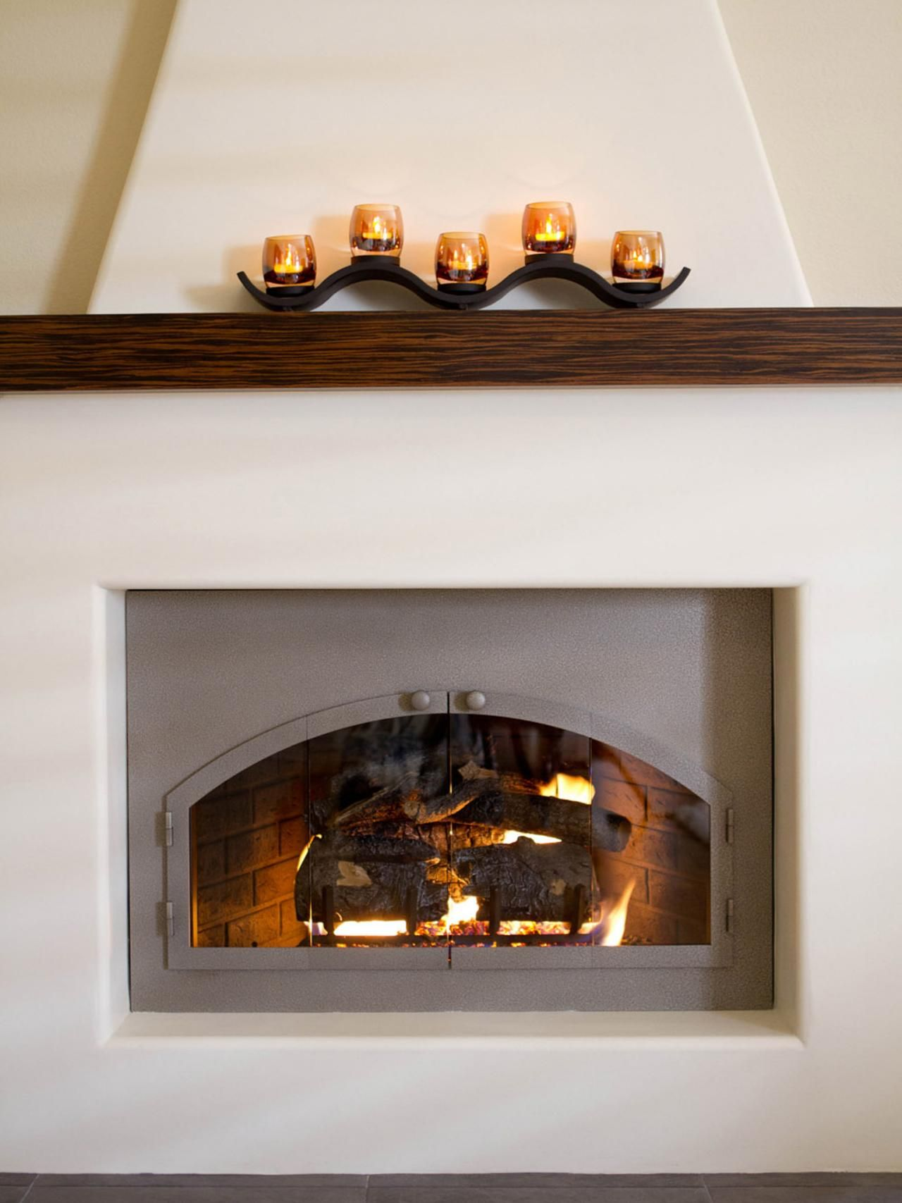 a stunning adobe fireplace is given a modern update in this
