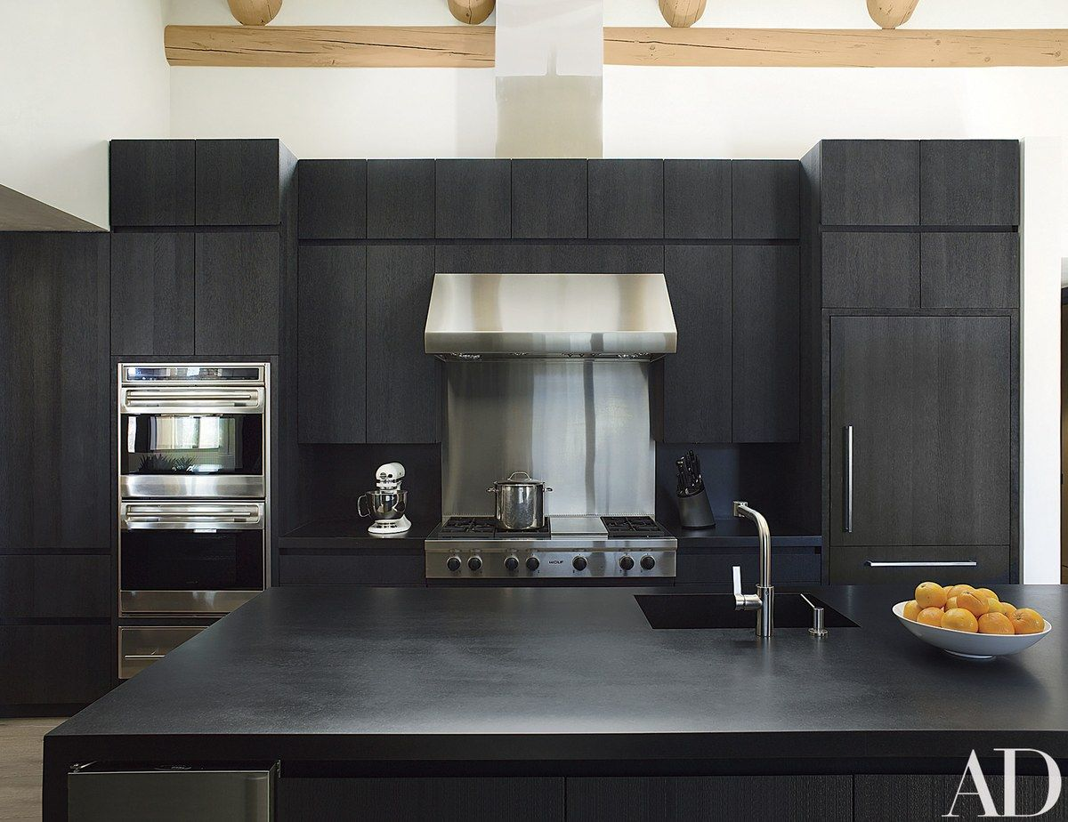 Cabinetry Of Blackened Wire Brushed Oak And Countertops Of Zimbabwe Black  Granite Make A Strong